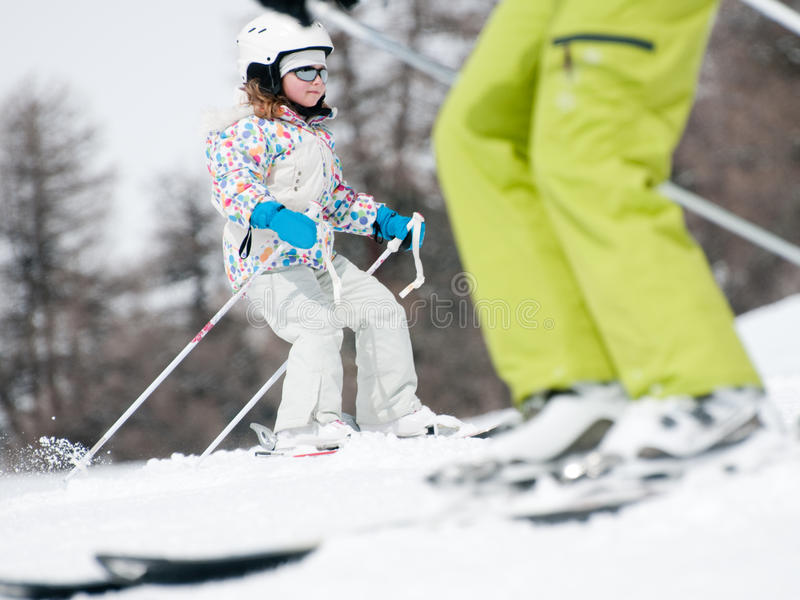 Family skiing royalty free stock photos