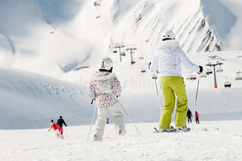 Family skiing royalty free stock images