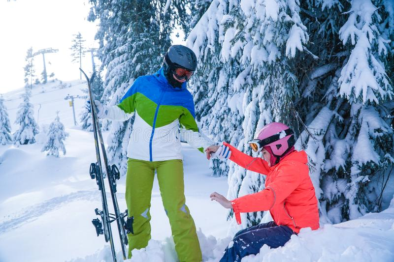 Family skiing holidays in the winter. mother and daughter holiday in the mountains stock image