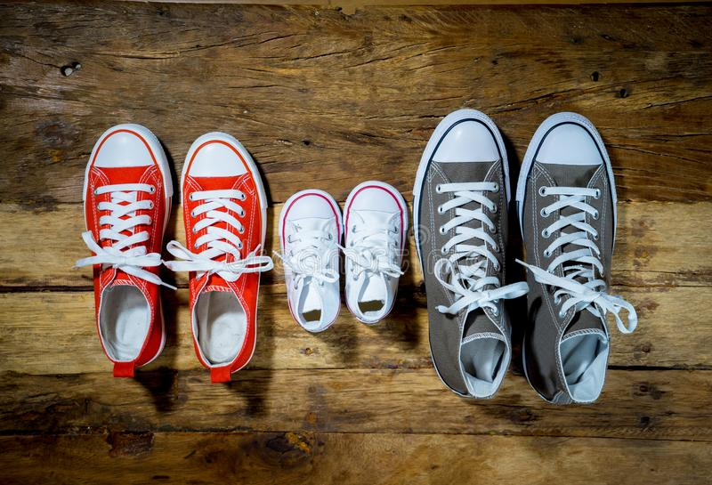 Family Sneakers canvas shoes parents and child on wood floor at home in happy lifestyle royalty free stock image