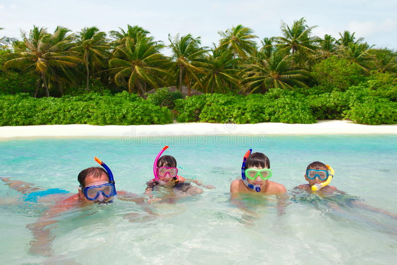 Family snorkeling in water royalty free stock photos