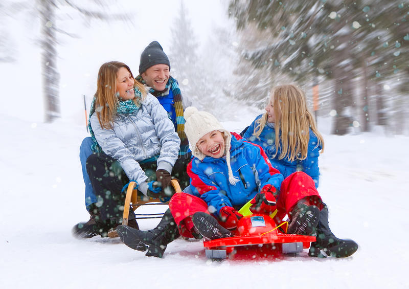 Family-snow-fun 06. Family is sledging in winterlandscape royalty free stock image