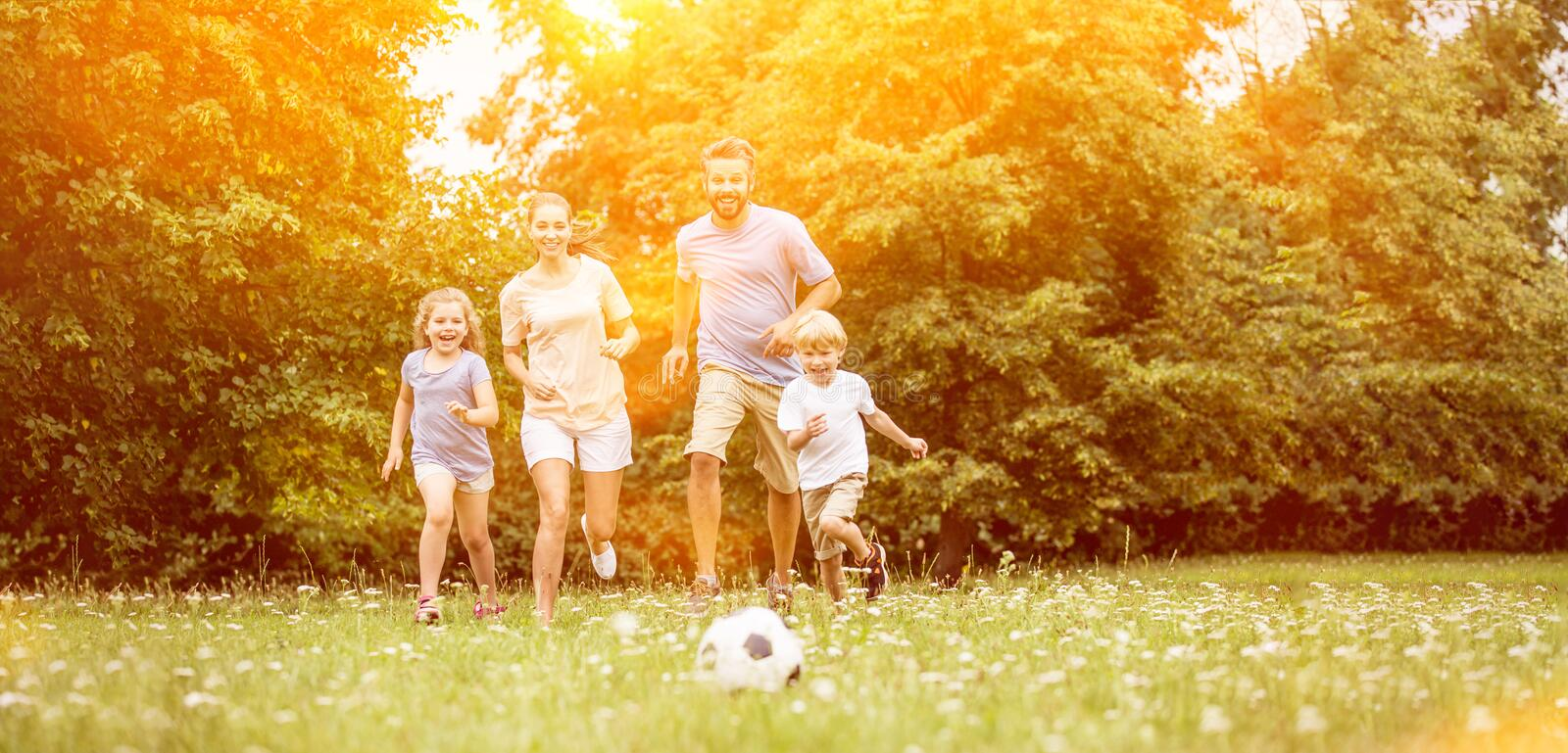 Family with soccer ball in summer. Playing and having fun royalty free stock images