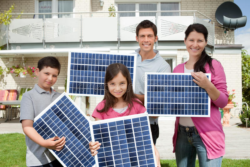 Family with solar panels stock photos