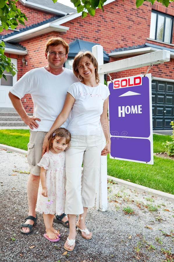 Download Family with Sold Home sign stock image. Image of happiness - 11751697