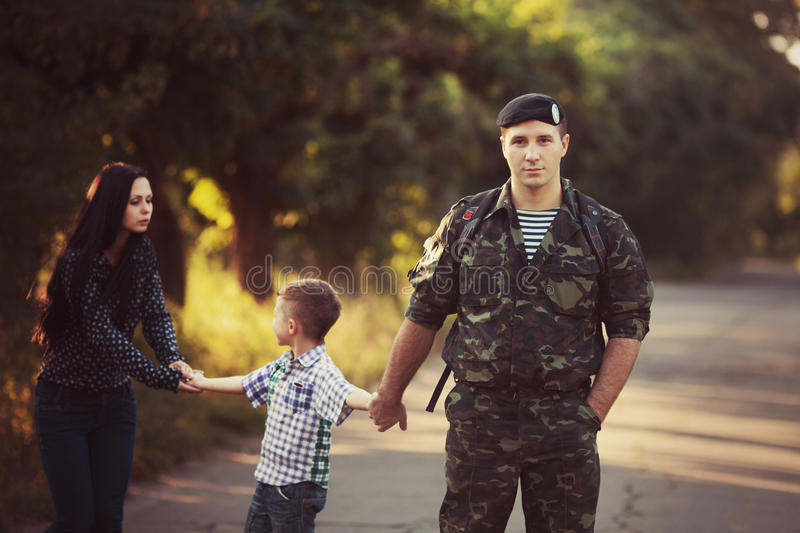 Family and soldier in a military uniform stock photos