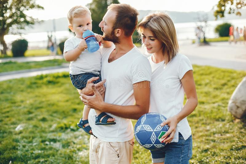 Family with son playing in a summer park stock photography
