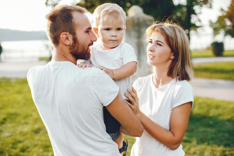 Family with son playing in a summer park stock photos
