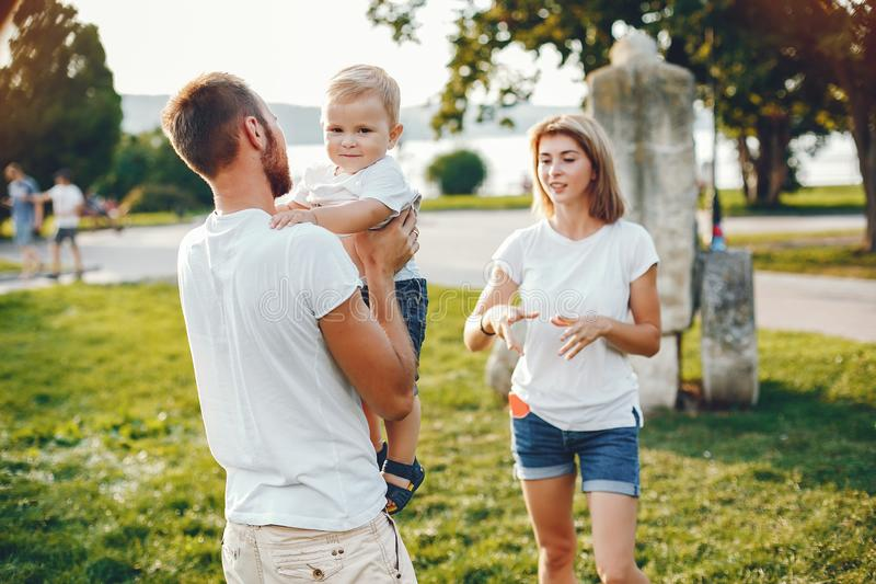 Family with son playing in a summer park stock images