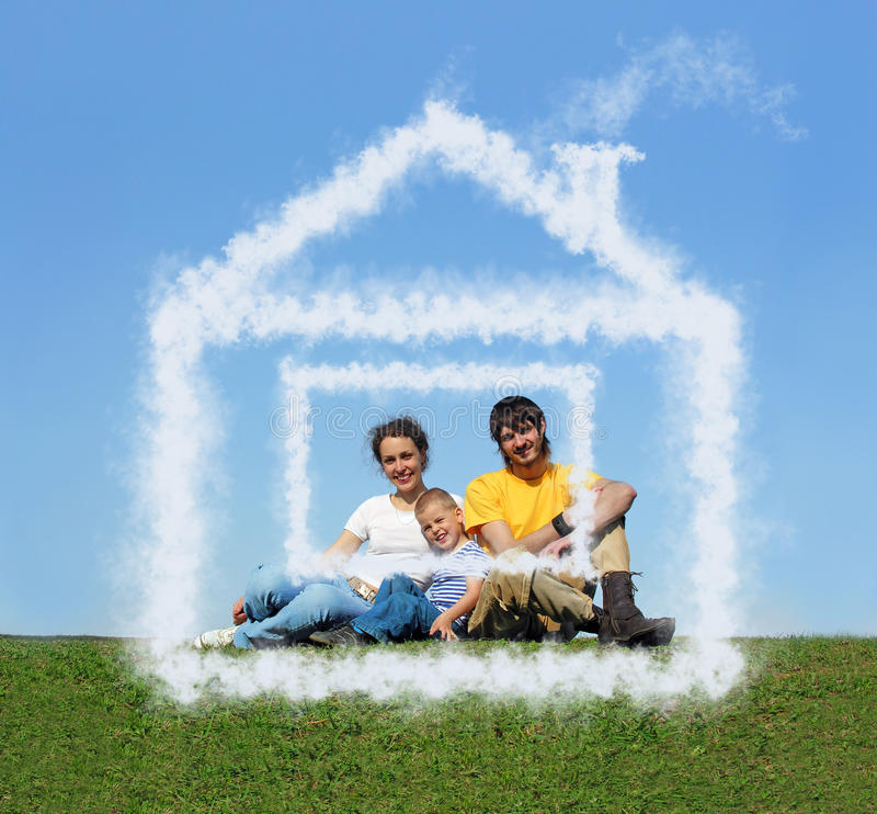 Family with son sitting cloud house on meadow royalty free stock images