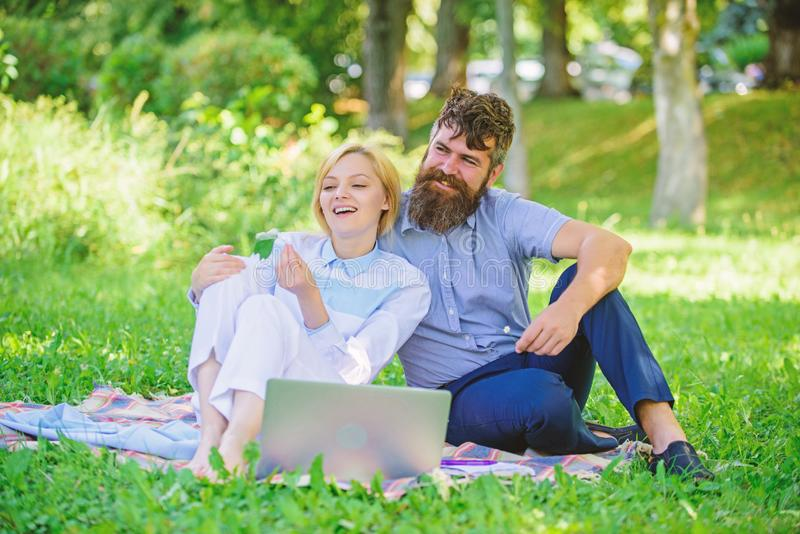 Family spend leisure outdoors work laptop. Stories of enduring family success and innovation. Couple in love or family stock image