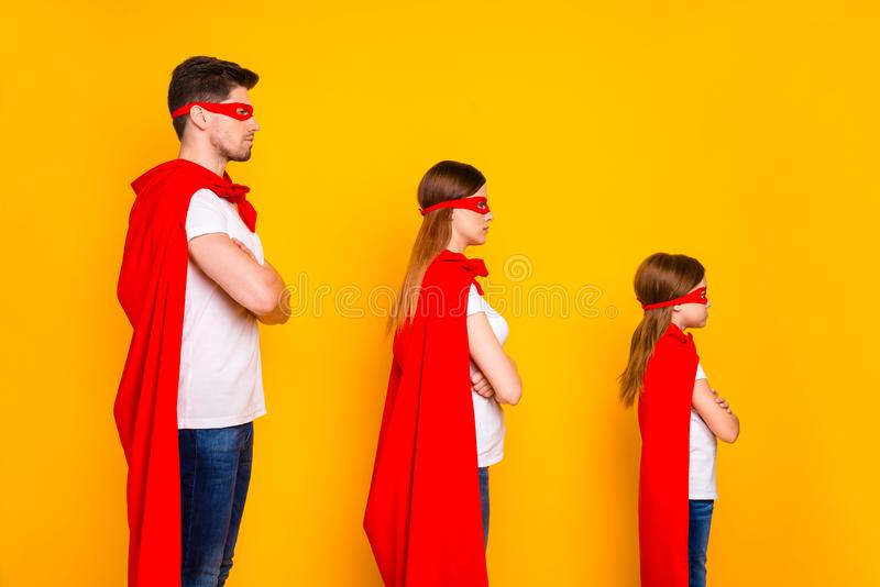 Family spending leisure time playing cartoon characters wear superhero costume isolated yellow background. Family spending leisure time, playing cartoon royalty free stock photos