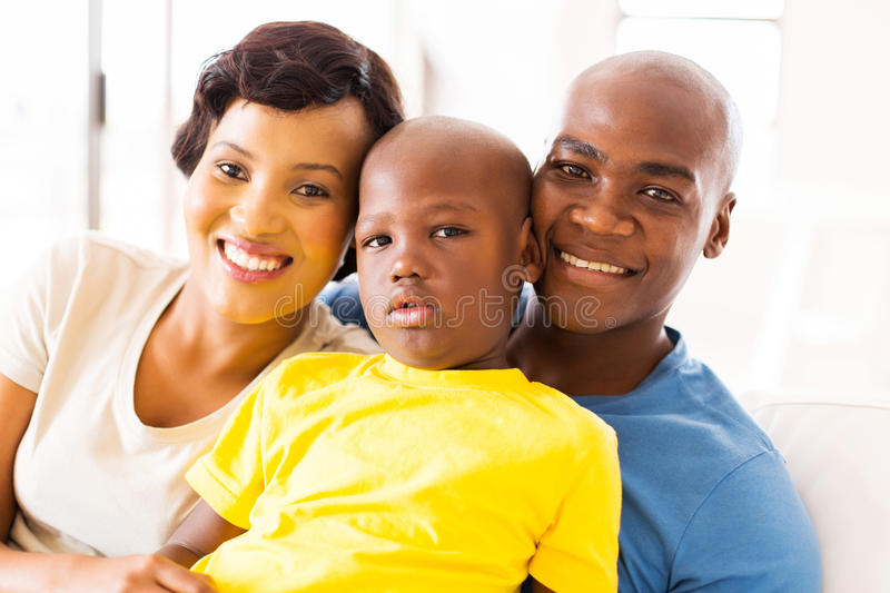 Family spending time together. Happy black family spending time together at home stock image