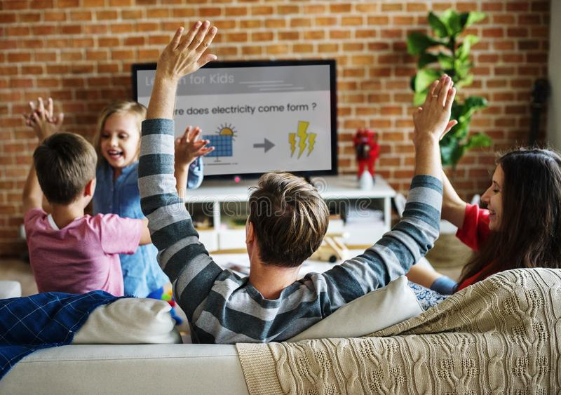 Family spending time together watching TV royalty free stock photography