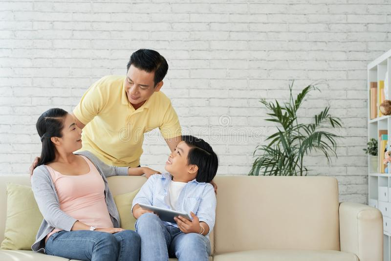Family spending weekend together. Happy Vietnamese family spending weekend together at home stock image