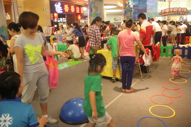 Family Spiritual Activities in the SHENZHEN Tai Koo Shing Commercial Center. In the SHENZHEN Tai Koo Shing Commercial Center,There is holding Family stock photography