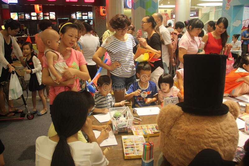 Family Spiritual Activities in the SHENZHEN Tai Koo Shing Commercial Center. In the SHENZHEN Tai Koo Shing Commercial Center,There is holding Family royalty free stock image