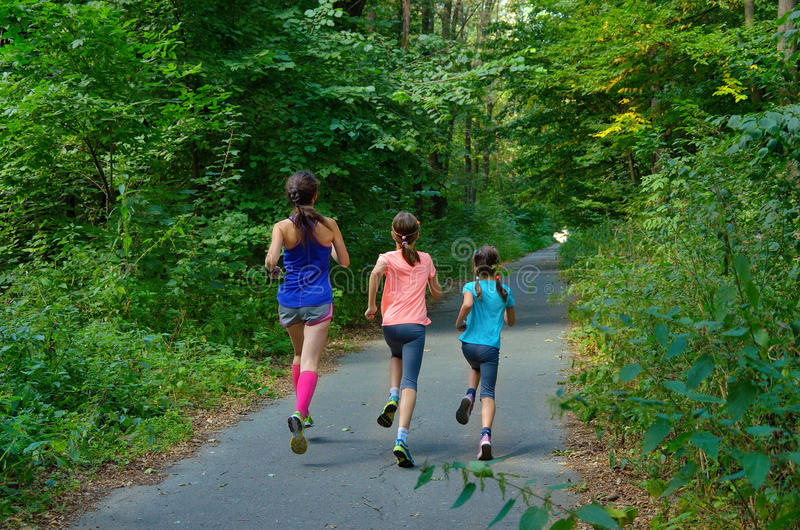 Family sport, mother and kids jogging outdoors stock photography