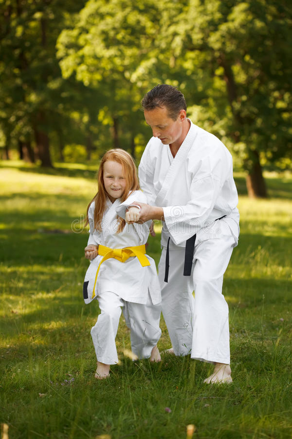 Family sports. Father teaching martial art in forest