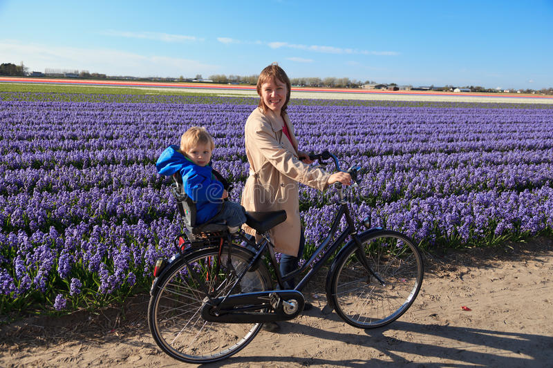 Family In Spring Flower Fields Royalty Free Stock Photography