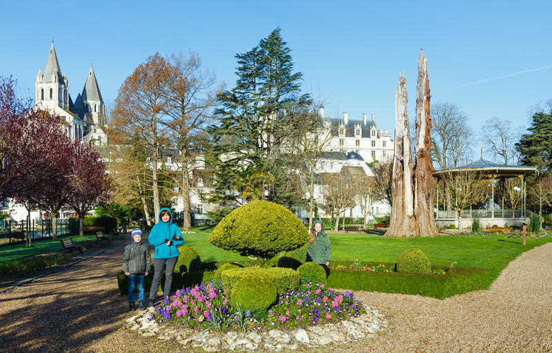 Family in spring park (Loches, France). Family in spring public park in Loches town (France royalty free stock image