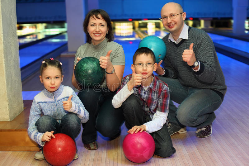 Download Family Of Squatting In Bowling Club Stock Photo - Image: 20698740