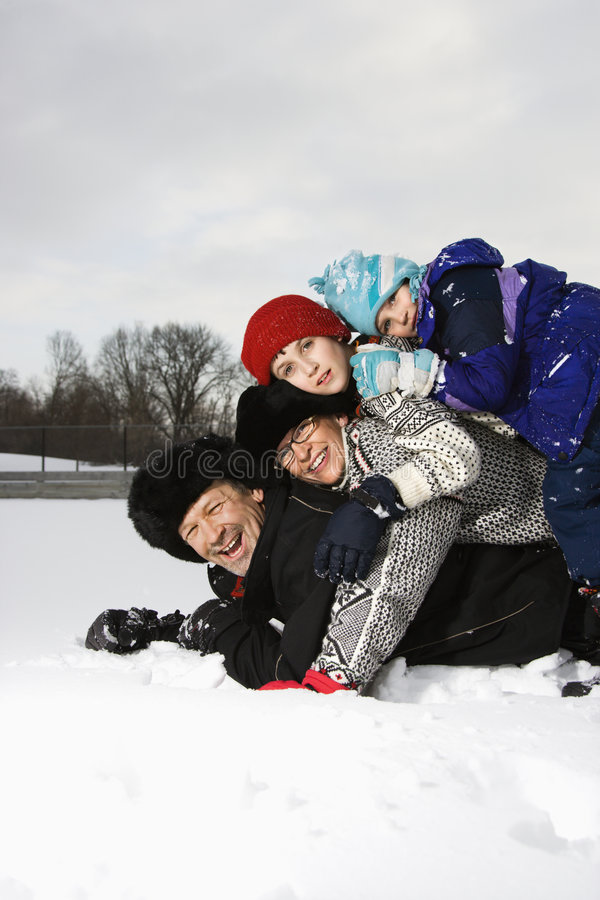 Download Family stacked in snow. stock photo. Image of middle, adults - 3531258