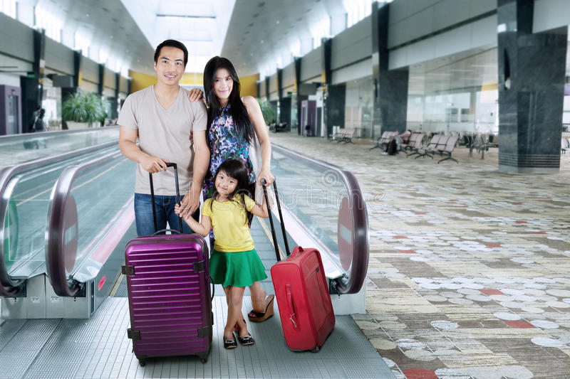 Family stand in airport hall stock photography