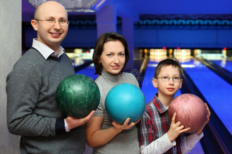 Download Family Stand And Hold Balls For Bowling Stock Photo - Image: 20698736
