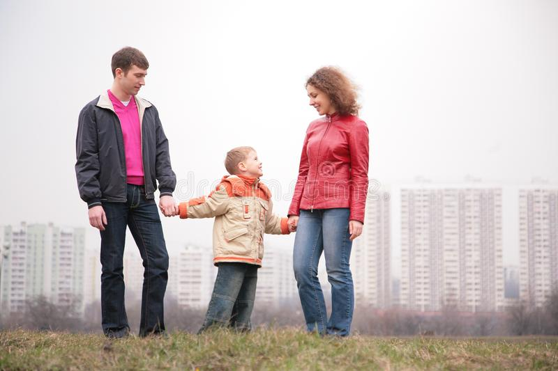 Family stand outdoor in city on spring royalty free stock image