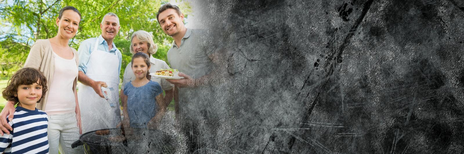 Family standing around bbq with grey grunge transition stock photography