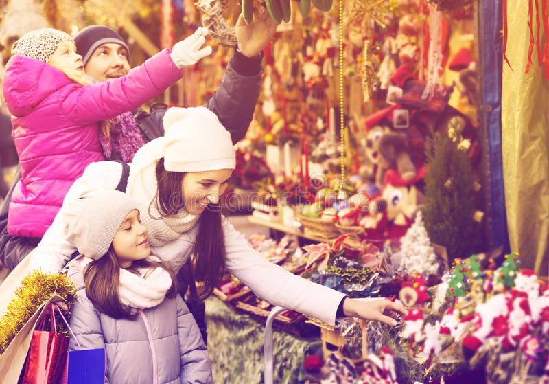 Family standing at coniferous souvenirs counter stock photos