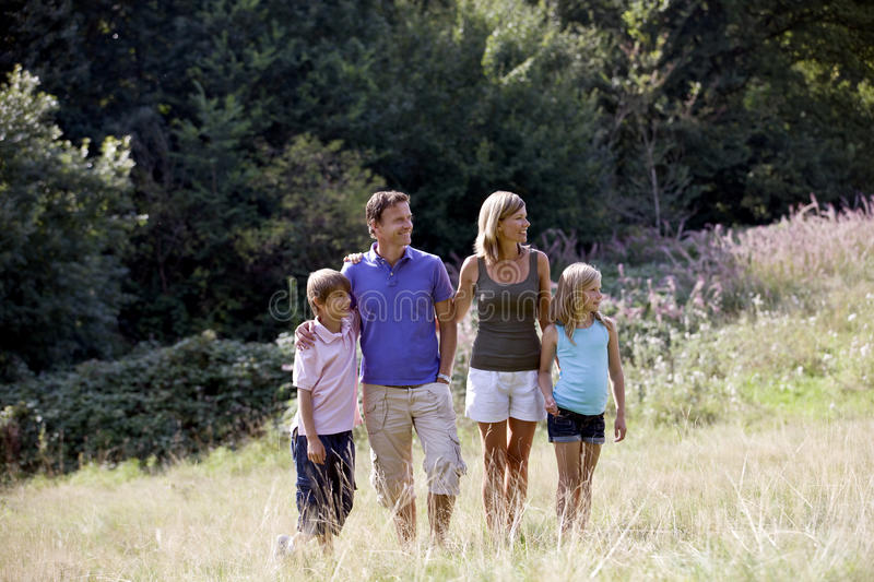 A family standing in a field stock photos