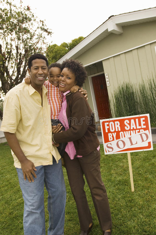 Download Family Standing In Front Of Billboard Stock Photo - Image: 29655880