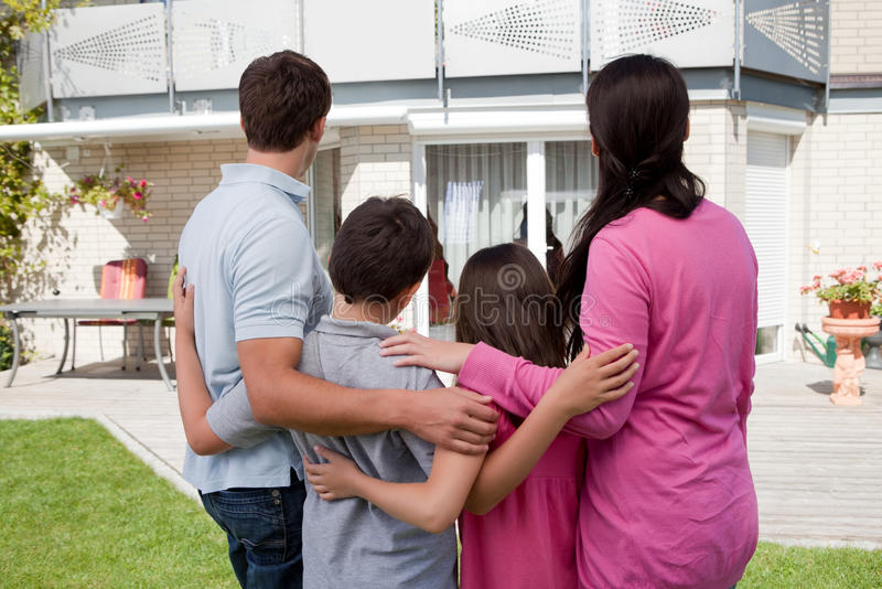 Download Family Standing In Front Of Their House Royalty Free Stock Photography - Image: 21660617