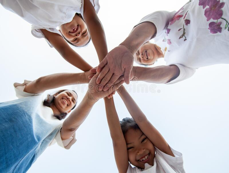 Family standing hands support together. Family generation join hands showing unity and teamwork. Asian family standing hands support together. Family generation stock image