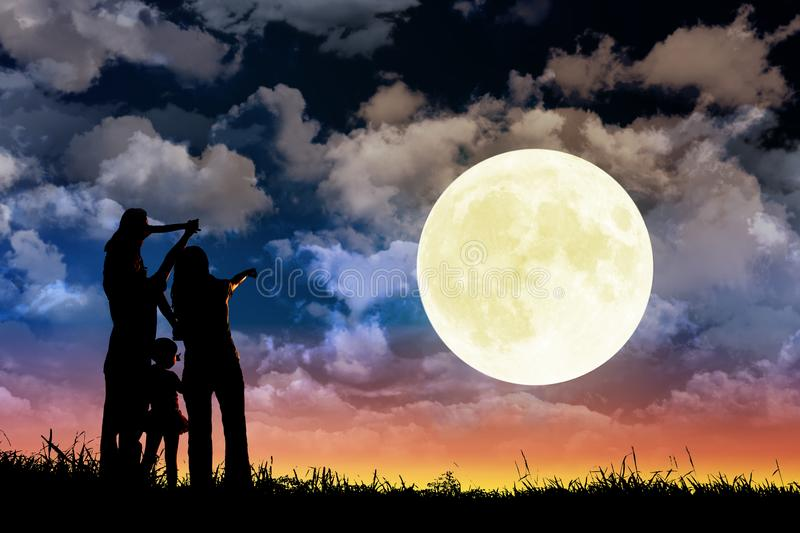 Family standing on hill and watching the moon.Celebrate Mid-autumn festival royalty free stock photography