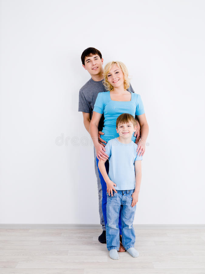 Download Family Standing In Line In Empty Room Stock Image - Image: 15039089