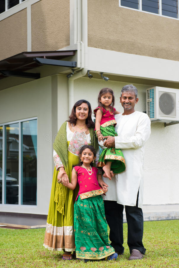 Family standing outside their new house. stock photography