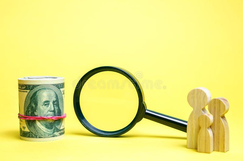 Family stands near money and magnifying glass. The concept of finding money and investment or sponsor. Find a job. Social help. Charitable Foundation. Limited stock image