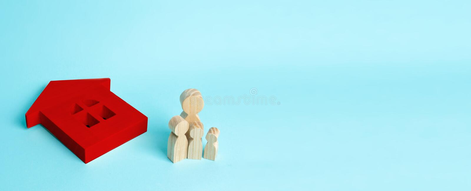 The family stands near the red ruined fallen house. Loss of housing, home insurance. Accident, natural disaster, war. Buying immobility Homeless family. People royalty free stock photo