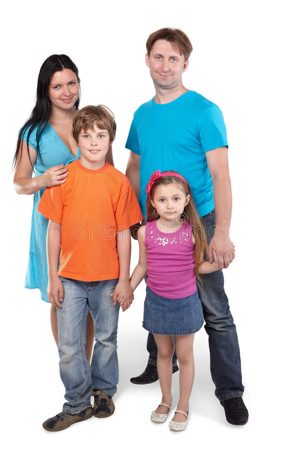 Family stands together holding hands. Family of four stands together holding hands royalty free stock photography