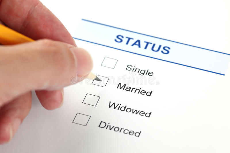 Family status form (Marital Status form). Marital status form with checkbox and human hand with pencil royalty free stock image