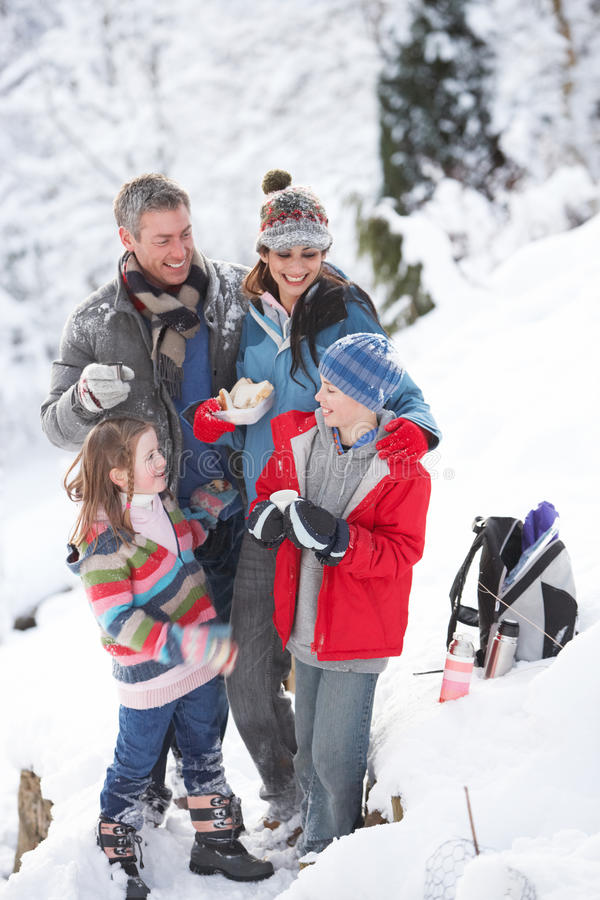 Family Stopping For Hot Drink And Snack stock photography