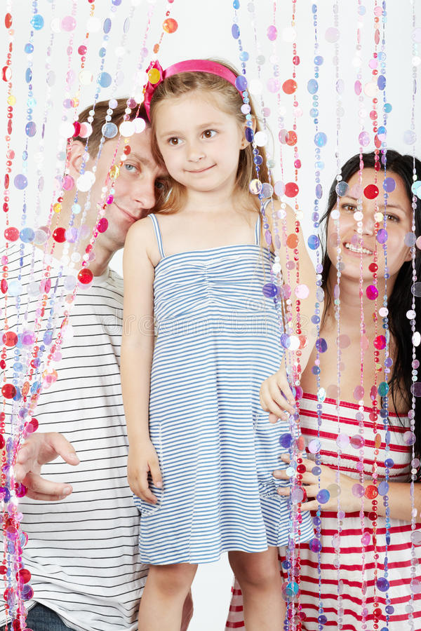 Download Family Strands Behind Curtains Of Plastic Beads Stock Photo - Image: 26281988
