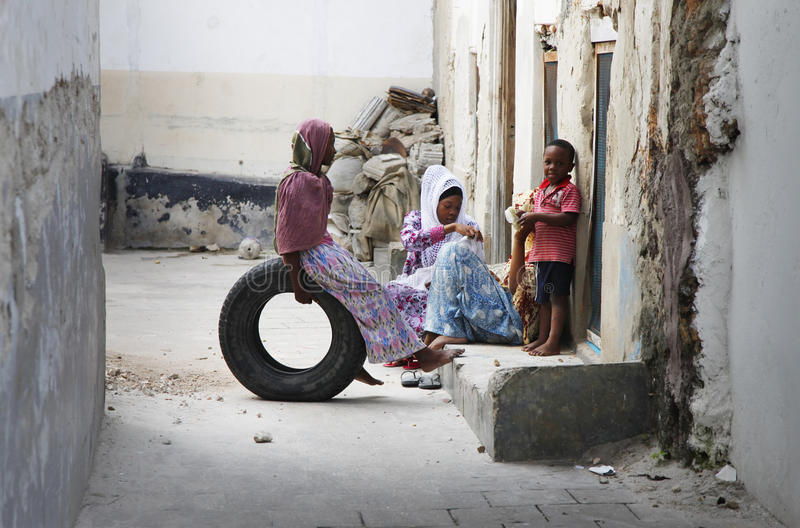 Family on the street Stone Town stock photography