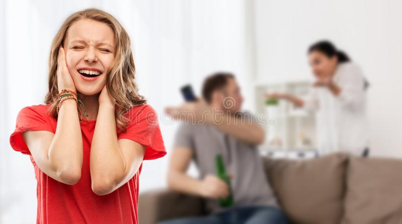 Stressed girl over her parents having fight royalty free stock photos