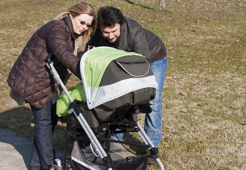 Download Family with Stroller stock photo. Image of parent, urban - 18950524