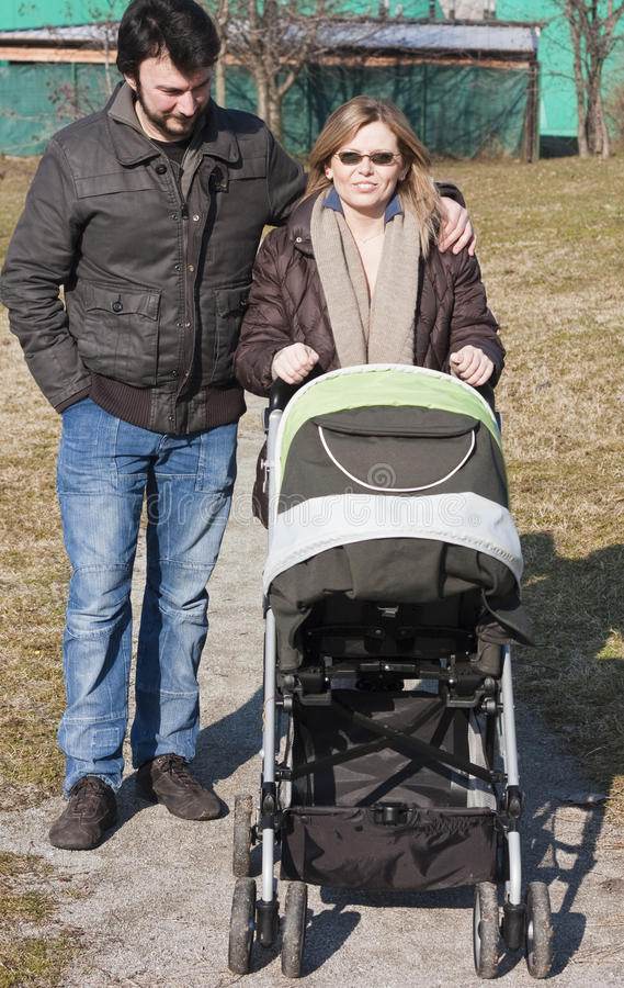 Family With Stroller Royalty Free Stock Photos