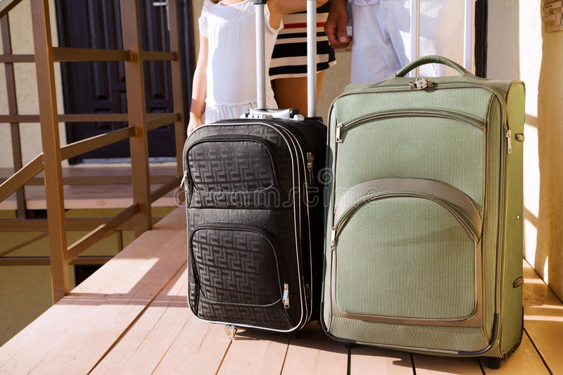 Family with suitcases standing at the door royalty free stock images